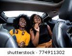 afro girls having fun in the car | Shutterstock . vector #774911302