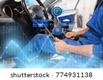 car service, repair, technology, maintenance and people concept - mechanic man with tablet pc computer making system diagnostic at workshop - stock photo