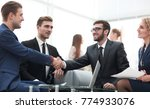 partners concluding deal and... | Shutterstock . vector #774933076