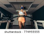 fit young woman running on... | Shutterstock . vector #774955555