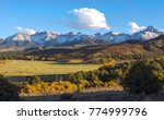 snowy peaks on colorado ranch ... | Shutterstock . vector #774999796