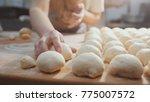 cooks roll the dough for baking ... | Shutterstock . vector #775007572