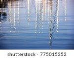 yacht mast water reflection   Shutterstock . vector #775015252