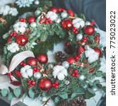 christmas wreath with xmas... | Shutterstock . vector #775023022
