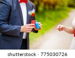 groom at wedding tuxedo smiling ... | Shutterstock . vector #775030726