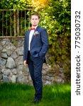 groom at wedding tuxedo smiling ... | Shutterstock . vector #775030732