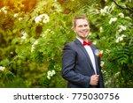 groom at wedding tuxedo smiling ... | Shutterstock . vector #775030756