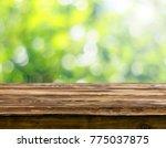 empty wooden table background | Shutterstock . vector #775037875