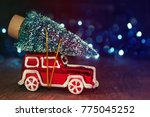 miniature red car with fir tree ... | Shutterstock . vector #775045252
