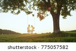 lens flare silhouette  young... | Shutterstock . vector #775057582