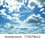 white clouds against a blue sky | Shutterstock . vector #775078612