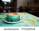 Flat White Coffee On Map Table