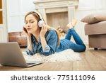 listening to music. beautiful... | Shutterstock . vector #775111096