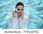 an attractive brunette model in ... | Shutterstock . vector #775123702