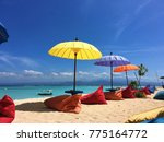 colorful umbrellas and beanbags ... | Shutterstock . vector #775164772
