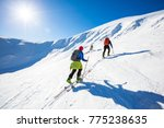 two skiers are climbing the... | Shutterstock . vector #775238635
