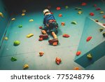 little boy climbing wall in... | Shutterstock . vector #775248796