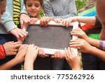 Small photo of Hands holding advert board