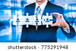 Small photo of HR - Human Resources - business concept with hand businessman and puzzle.