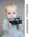 cute baby girl playing with... | Shutterstock . vector #775296352