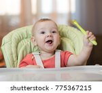happy baby boy in high chair... | Shutterstock . vector #775367215