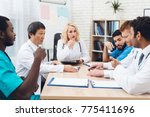 a group of doctors from... | Shutterstock . vector #775411696