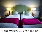 Small photo of Twin Beds with red Blanket and Lamp on either side