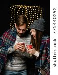 couple warming their hands with ... | Shutterstock . vector #775440292