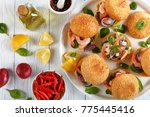 tasty burgers or pinchos with... | Shutterstock . vector #775445416
