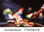 chef cook the bbq seafood in... | Shutterstock . vector #775458478
