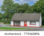 a cute bungalow in the... | Shutterstock . vector #775460896