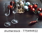 two spare glasses at the... | Shutterstock . vector #775494922
