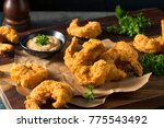 homemade southern fried cajun... | Shutterstock . vector #775543492