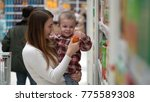 young mother and son buy water... | Shutterstock . vector #775589308