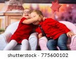 boy and girl twins in hug at... | Shutterstock . vector #775600102