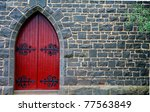 Red Wooden Door In Bluestone...