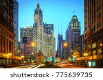 Chicago, IL - July 1, 2014: To celebrate America's Independence Day, a nine-story tall American flag hangs from the Wrigley Building in downtown Chicago. (1940) - stock photo