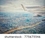 view from airplane   on top of... | Shutterstock . vector #775675546