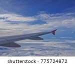 Small photo of aircraft Wing on the sky Airline Business