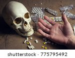 Skull  Tablets And Hand Of A...