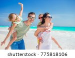 young family of four on beach... | Shutterstock . vector #775818106
