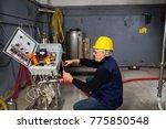 technician at maintenance work... | Shutterstock . vector #775850548