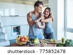 happy sporty couple is... | Shutterstock . vector #775852678