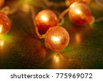 electric garland with red bulbs ...   Shutterstock . vector #775969072