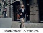 handsome businessman. handsome... | Shutterstock . vector #775984396
