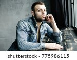confident young man in... | Shutterstock . vector #775986115