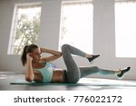 fitness woman doing crunches... | Shutterstock . vector #776022172