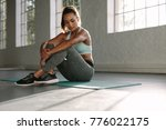 healthy woman sitting yoga mat... | Shutterstock . vector #776022175