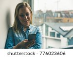 young woman with phone at home... | Shutterstock . vector #776023606
