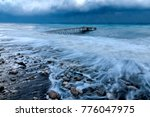 Wharf In The Sea During A...